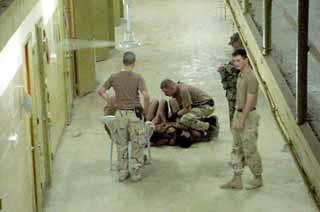 abu_prison_kneel.jpg